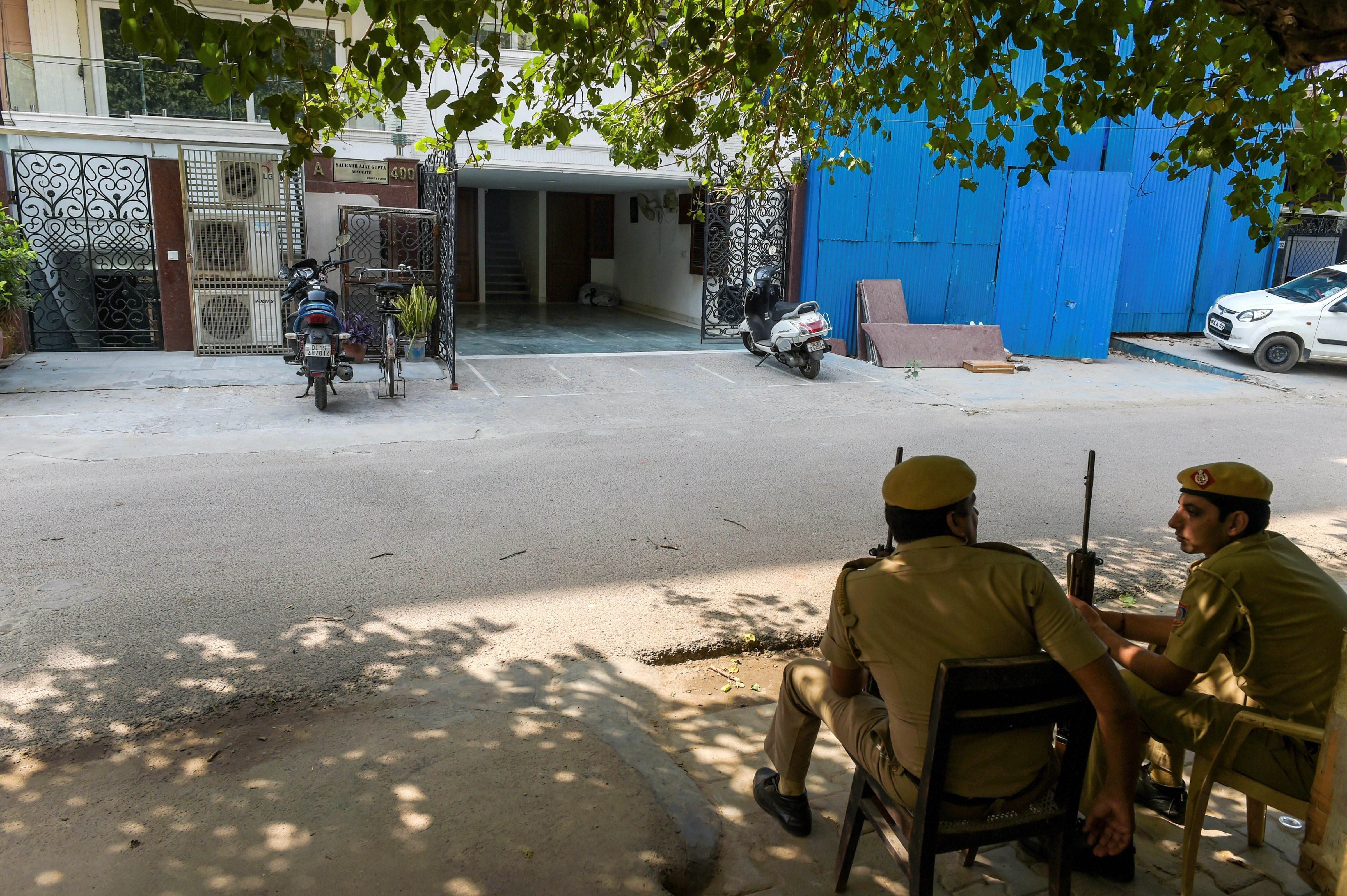 Police constables outside as tax officials conduct a search on Delhi transport minister Kailash Gahlot's permises on Wednesday,.