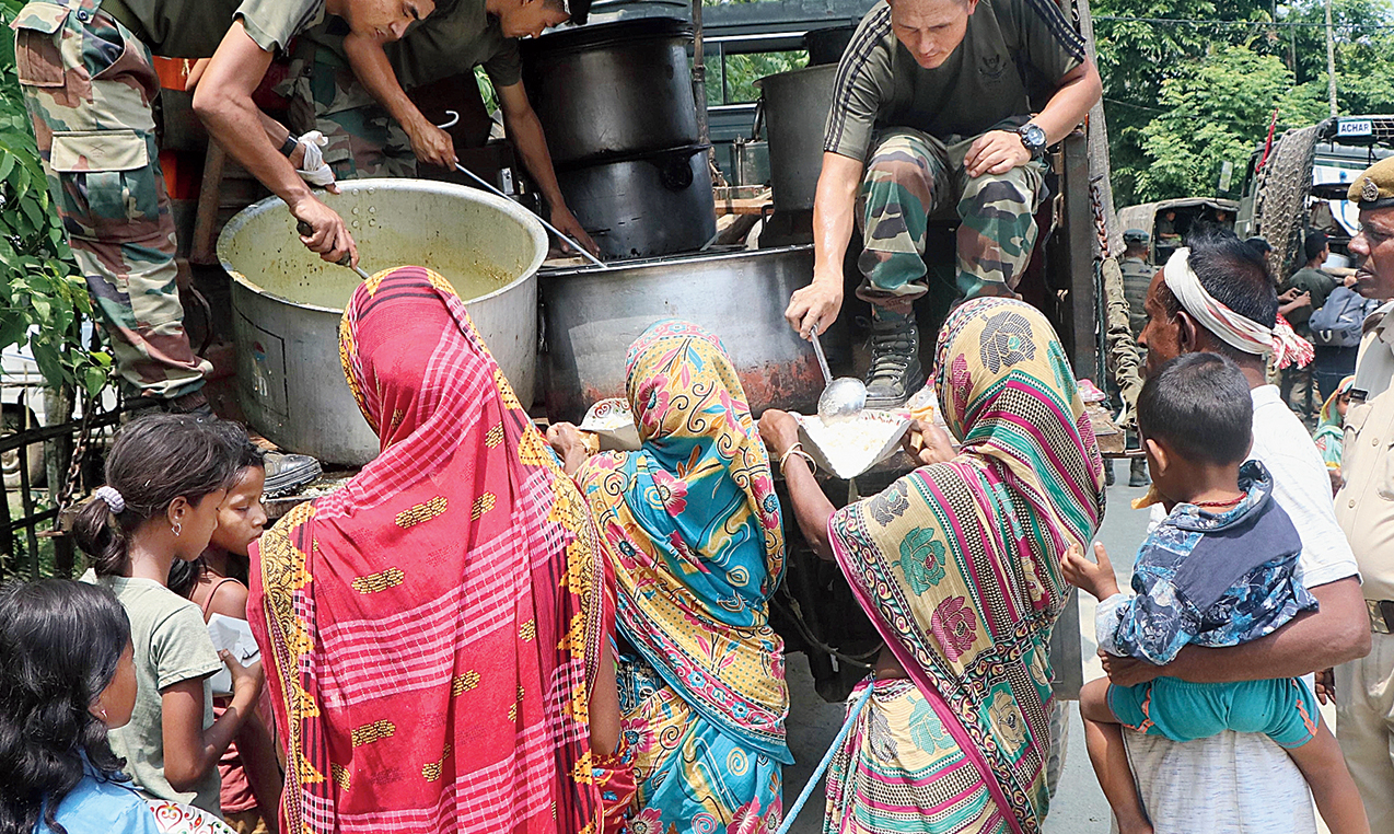 The army serves meals to people at a relief camp at Goroimari in Assam's Kamrup district on Sunday.