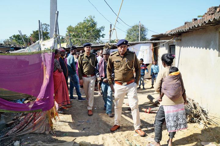 Police detain a youth at Mousi Bari Basti in Shalimar, Ranchi, on Monday