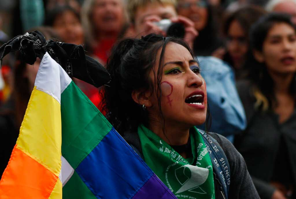 A woman shouts slogans during the International Women's Day march in La Paz, Bolivia.