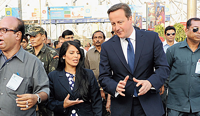 Priti Patel with David Cameron (centre in blue suit) at Howrah Station in November 2013