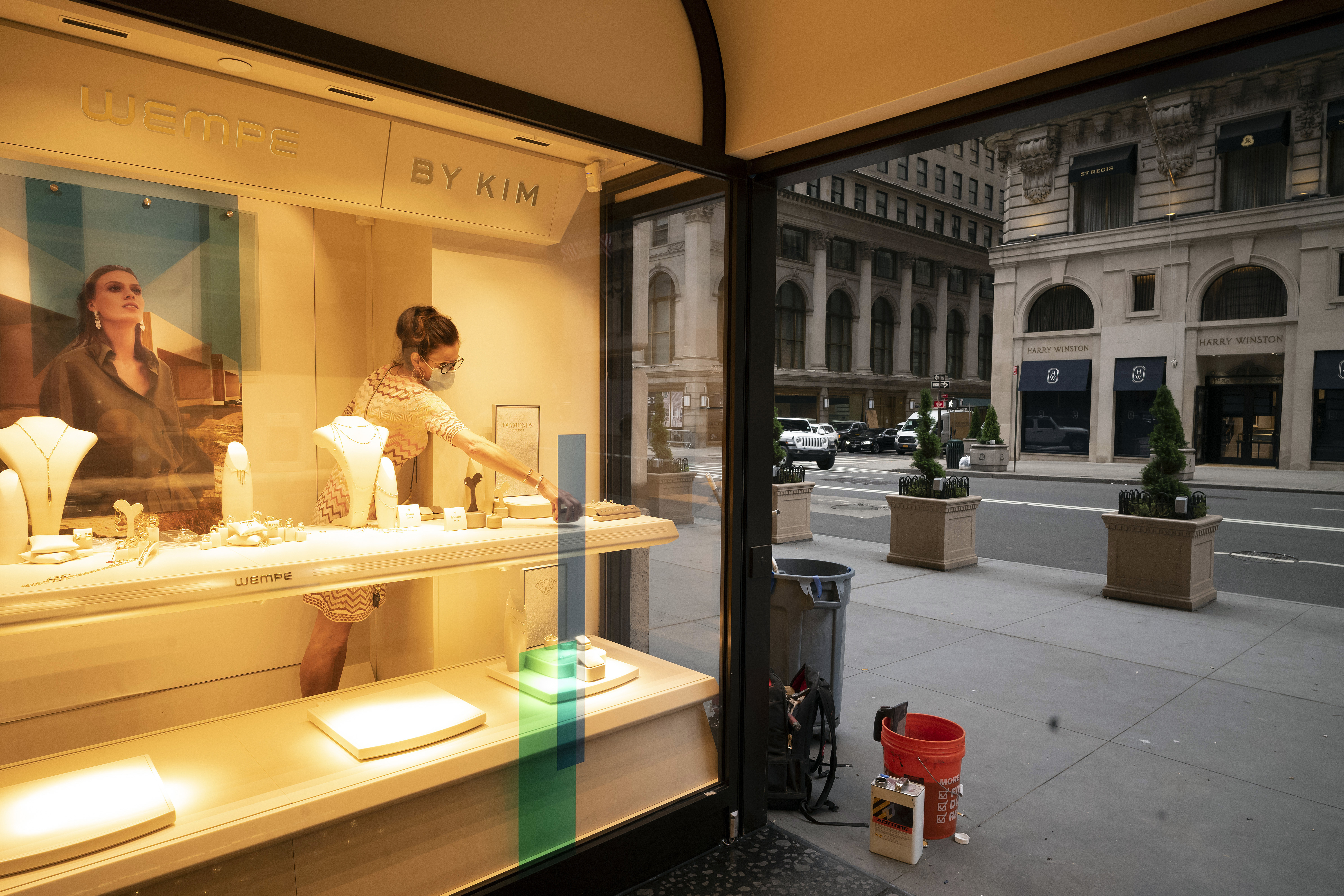 A Wempe store employee places jewellery in a store window on Thursday, in New York's Fifth Avenue shopping district