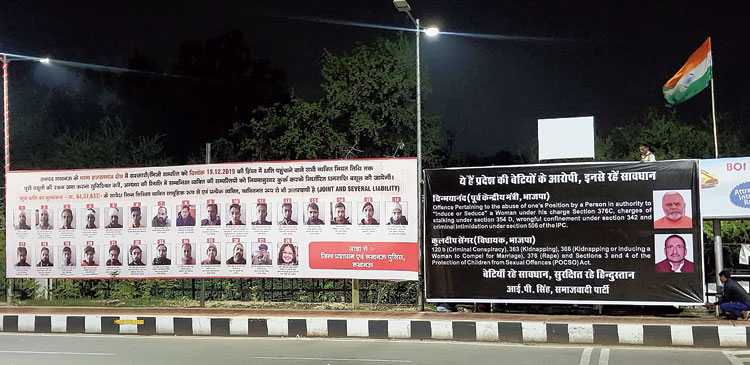 "The billboard on the right features former central minister and BJP leader Chinmayanand  and former BJP legislator Kuldeep Singh Sengar while that on the left shows the ""name-and- shame"" pictures of those accused of vandalism during the anti-CAA  protests."