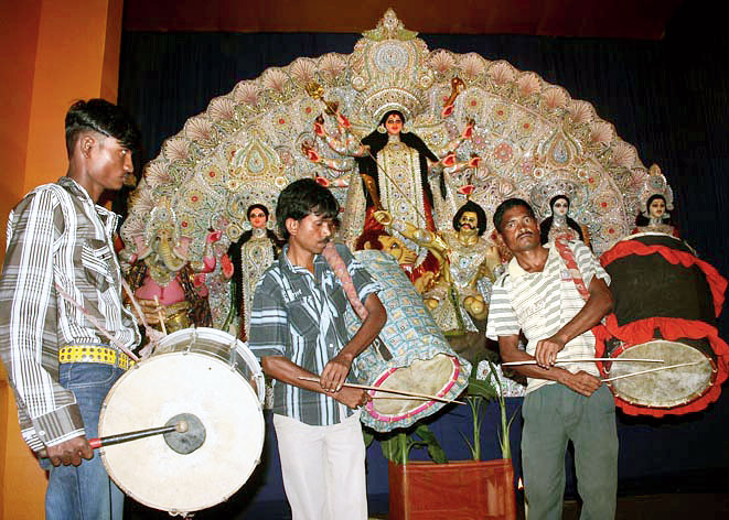 Durga Puja: Big budgets, tattered clothes