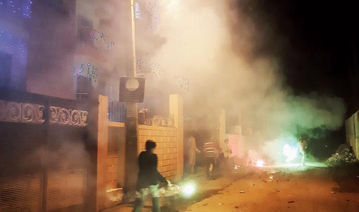 Thick smoke from firecrackers engulfs HB Road in Kokar, Ranchi, on Sunday night