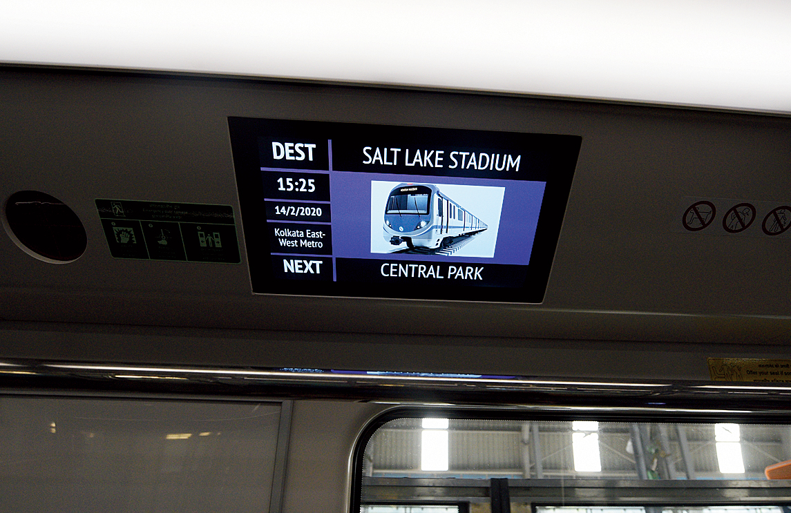 The display board shows the next station.