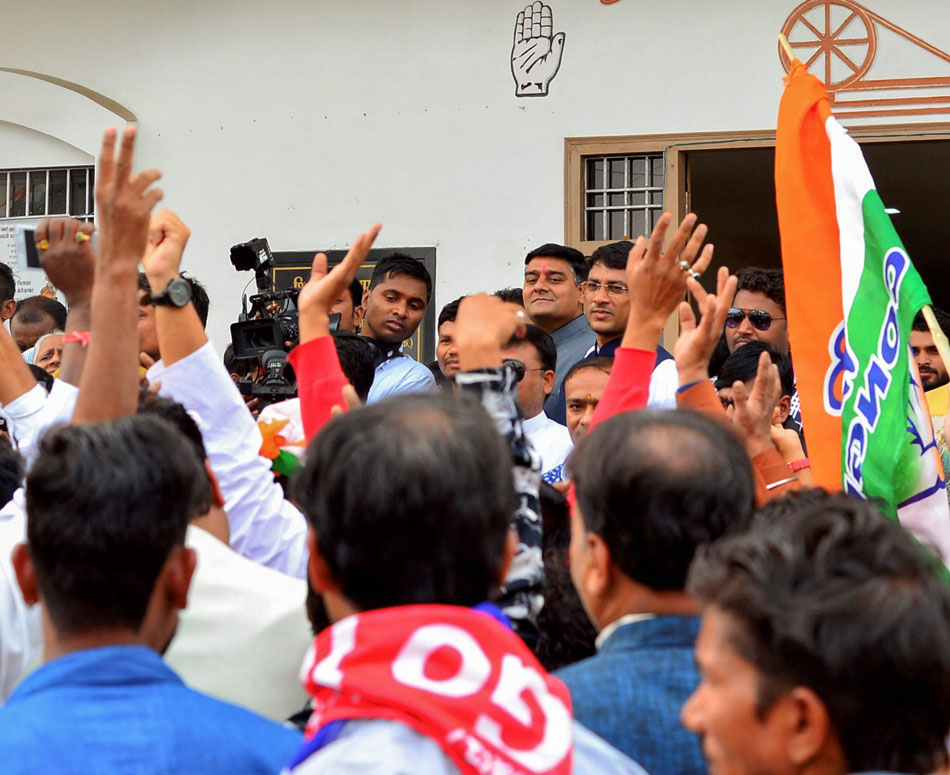 Congress workers celebrate the party's good show in the Chhattisgarh  Assembly elections at the party office in Raipur.