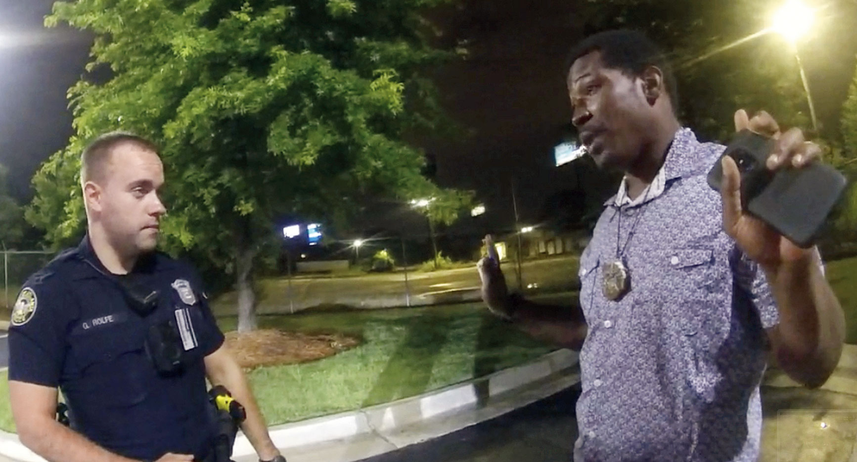 Footage shows Rayshard Brooks speaking with officer Garrett Rolfe in the parking lot of a Wendy's restaurant in Atlanta on Friday.