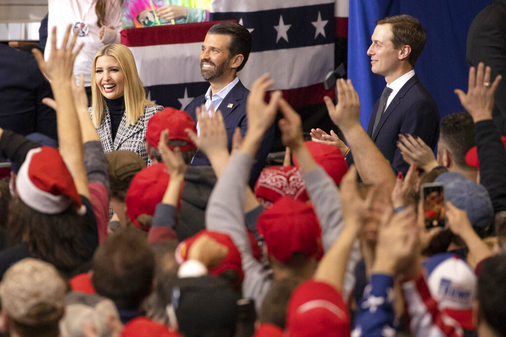 In this Monday, February 10, 2020, file photo, audience cheers as President Donald Trump introduces his daughter Ivanka Trump, left, son Donald Trump Jr., center, and son-in-law Jared Kushner during a campaign rally. Ivanka and Jared will accompany Trump during his visit to India.