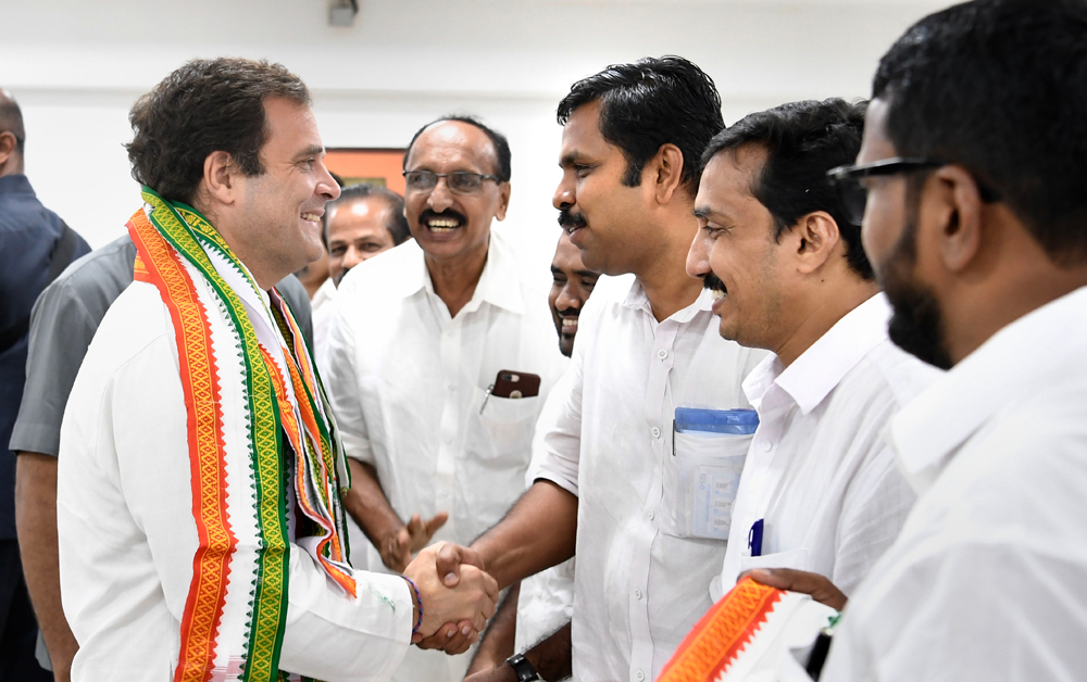 Congress President Rahul Gandhi greets party leaders and activists in Kozhikode, Friday, June 7, 2019.
