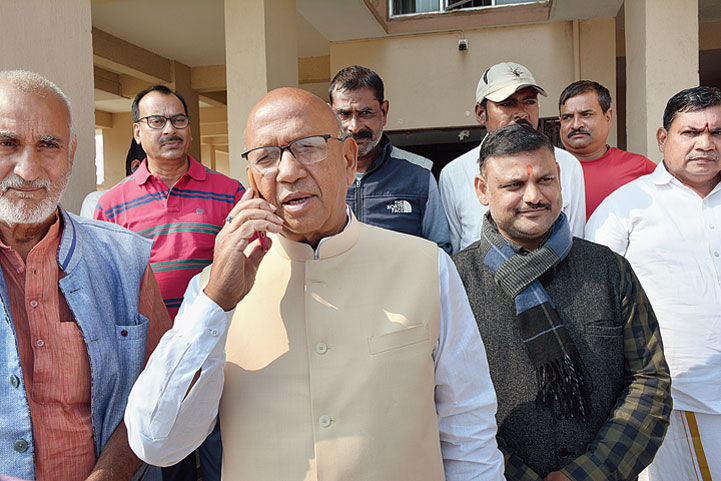 Saryu Roy with his supporters outside his temporary residence in Baridih, Jamshedpur, on Sunday.