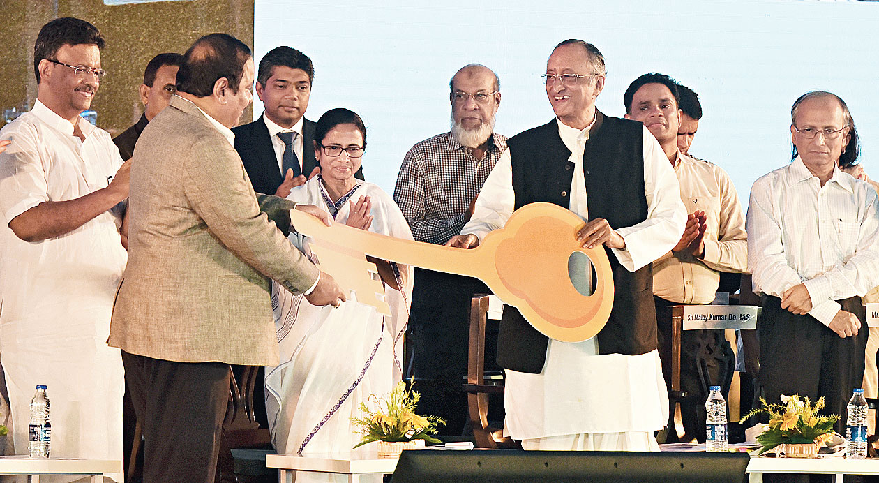 Mamata Banerjee with Amit Mitra, Firhad Hakim and other officials in Calcutta on Thursday.