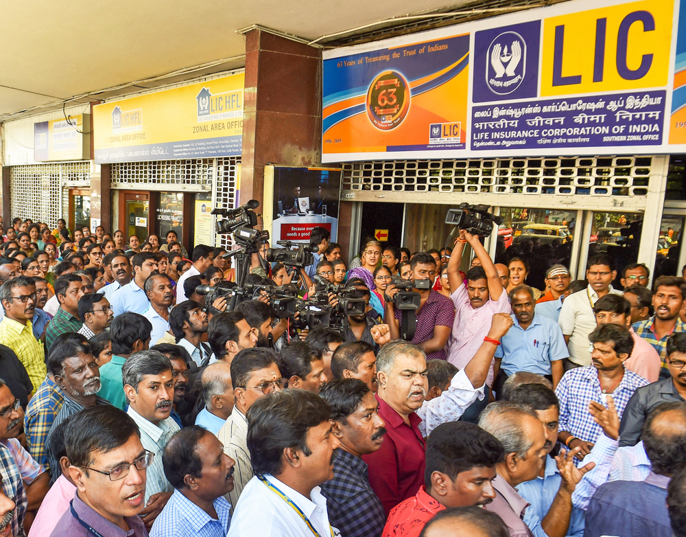 Members of All India Insurance Employees Association stage a demonstration against the govt's decision to sell the partial stake in LIC through an initial public offer, outside southern regional headquarters of the Life Insurance Corporation of India, in Chennai, Monday, February 3, 2020.