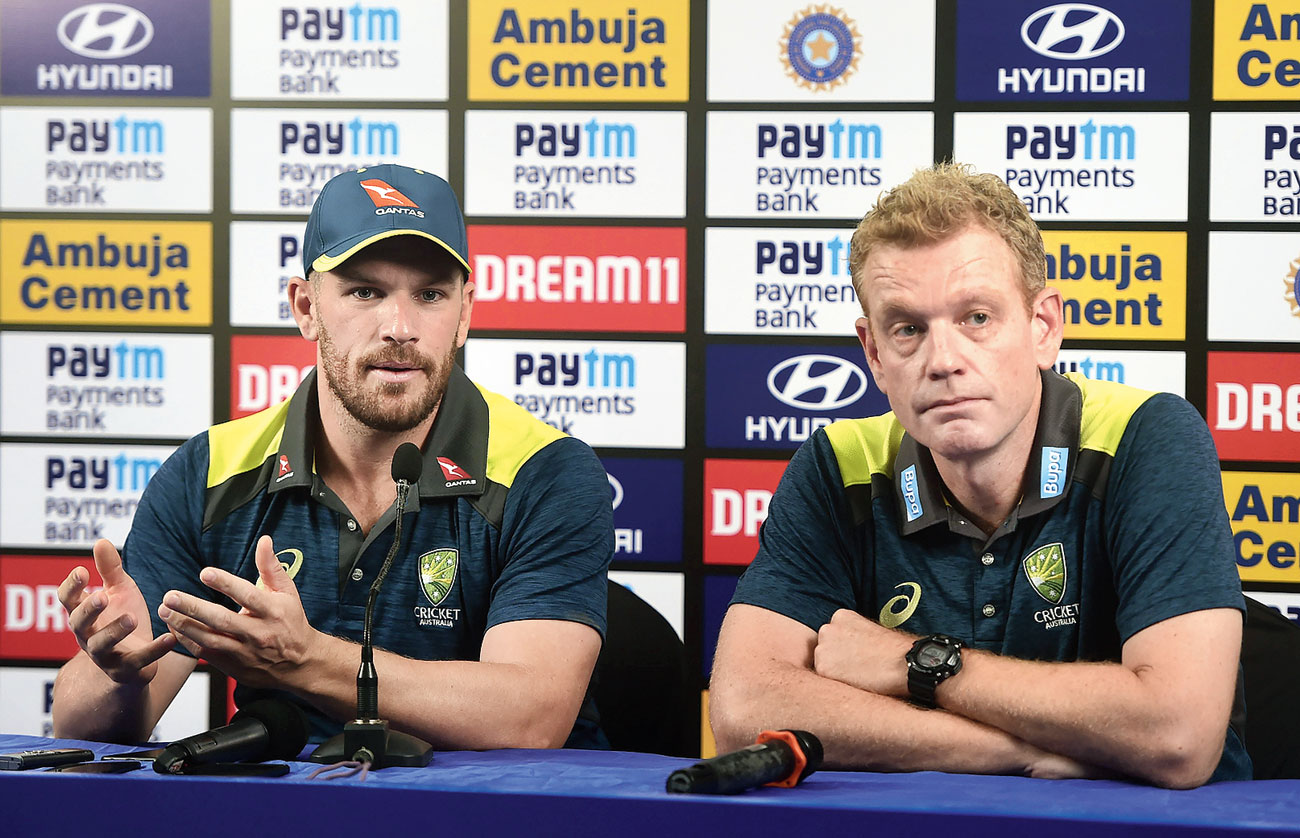 Australia captain Aaron Finch (left) with deputy coach Andrew McDonald in Mumbai on Friday