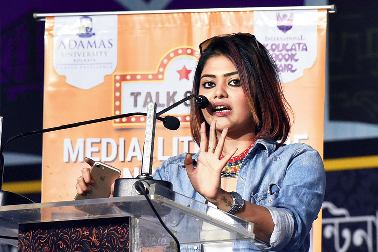 Actress Saayoni Ghosh speaks at the programme