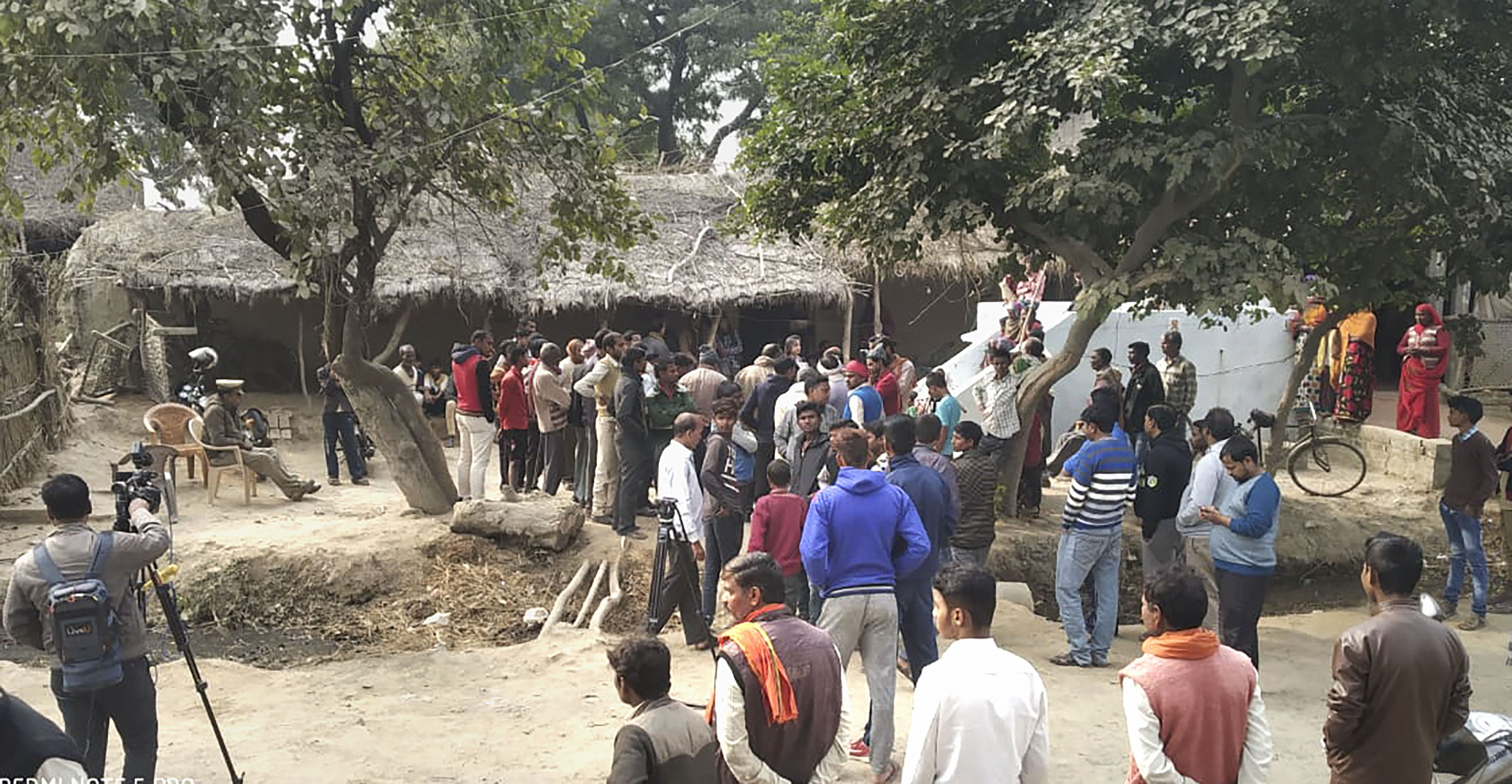 Administration and police officials at the Sindupur village where a rape victim was allegedly set ablaze by five men, in Unnao district, Saturday, December 7, 2019.