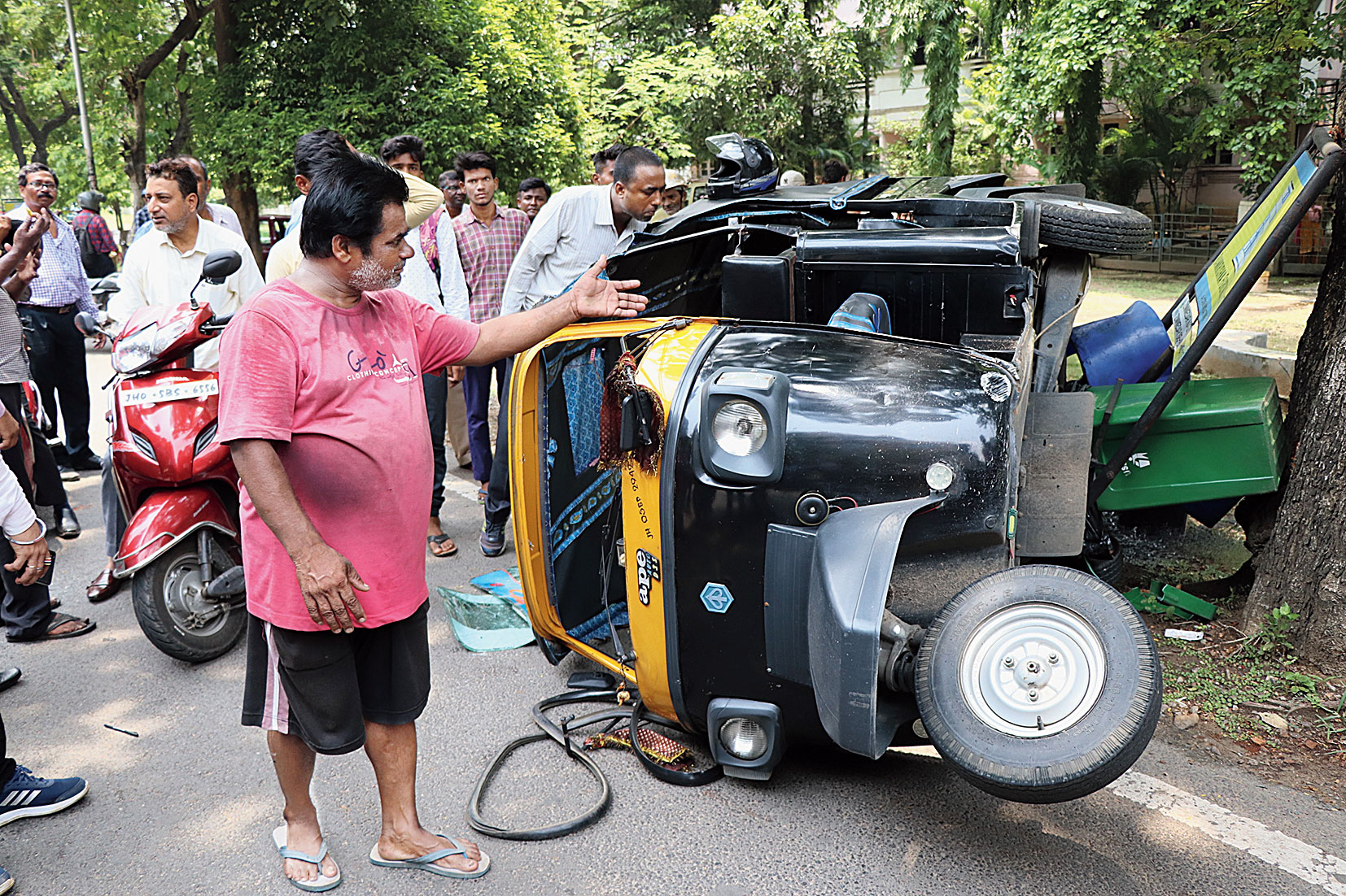 The auto lies on its side on Subernarekha Link Road in Jamshedpur on Thursday.