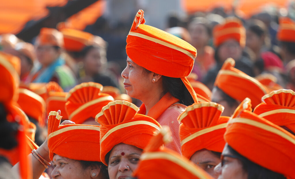 Bharatiya Janata Party's supporters wait for the Indian Prime Minister Narendra Modi's address during a campaign rally ahead of Delhi state elections in New Delhi, on Monday
