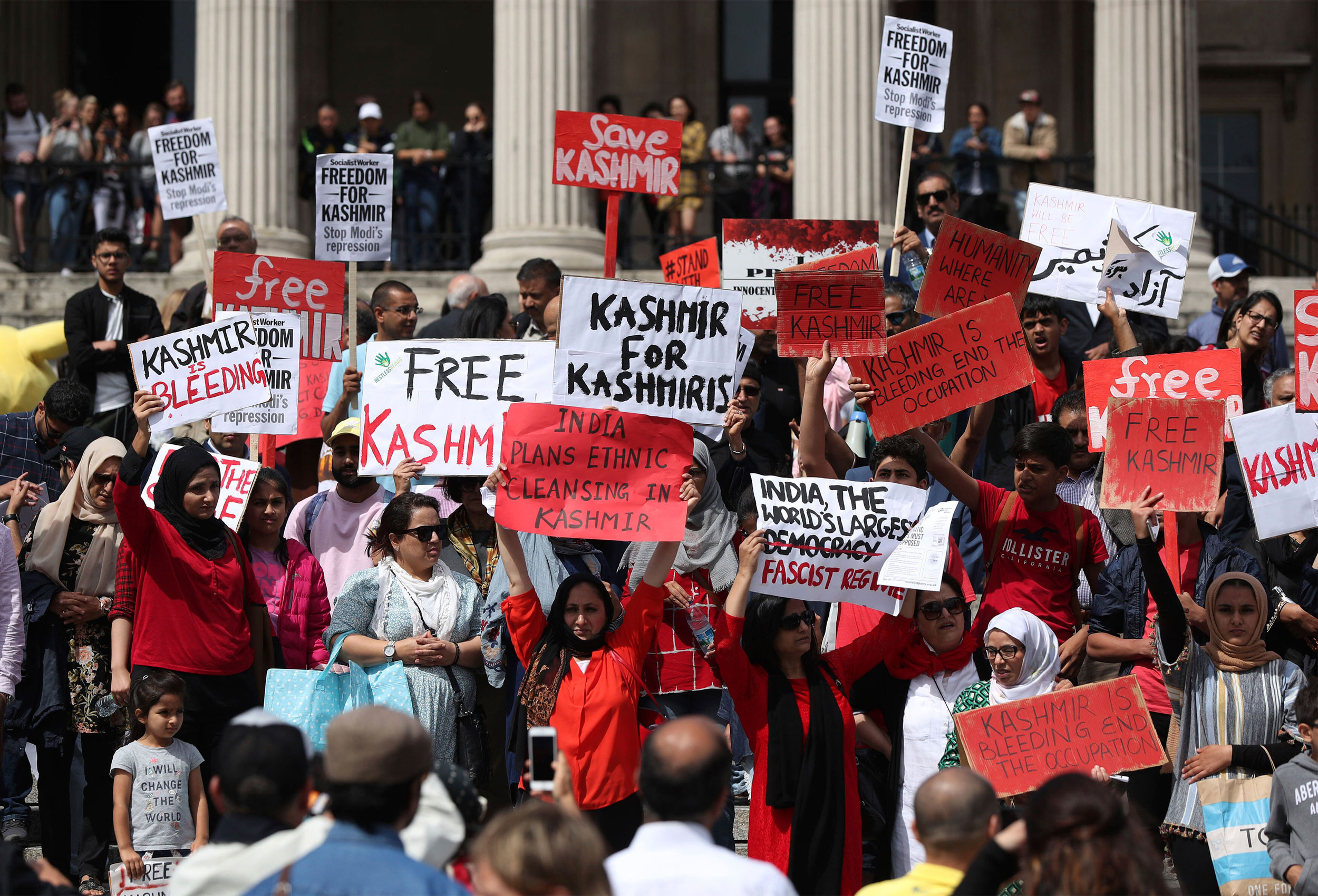 Demonstrators wave various signs during a Freedom For Kashmir protest against the government in central London on August 10, 2019.