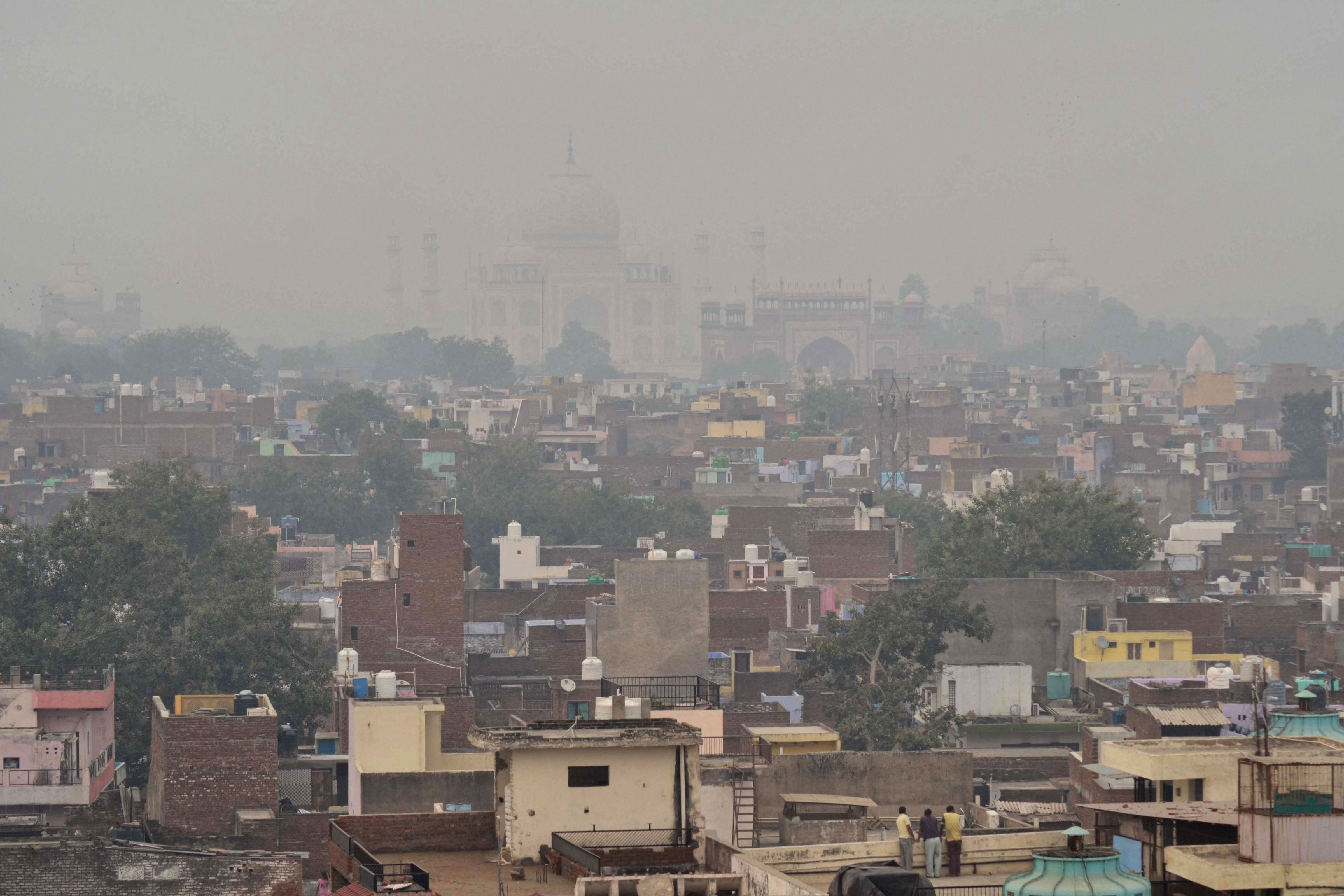 A view of Agra city with the Taj Mahal shrouded in smog, in Agra, Wednesday, October 30, 2019.