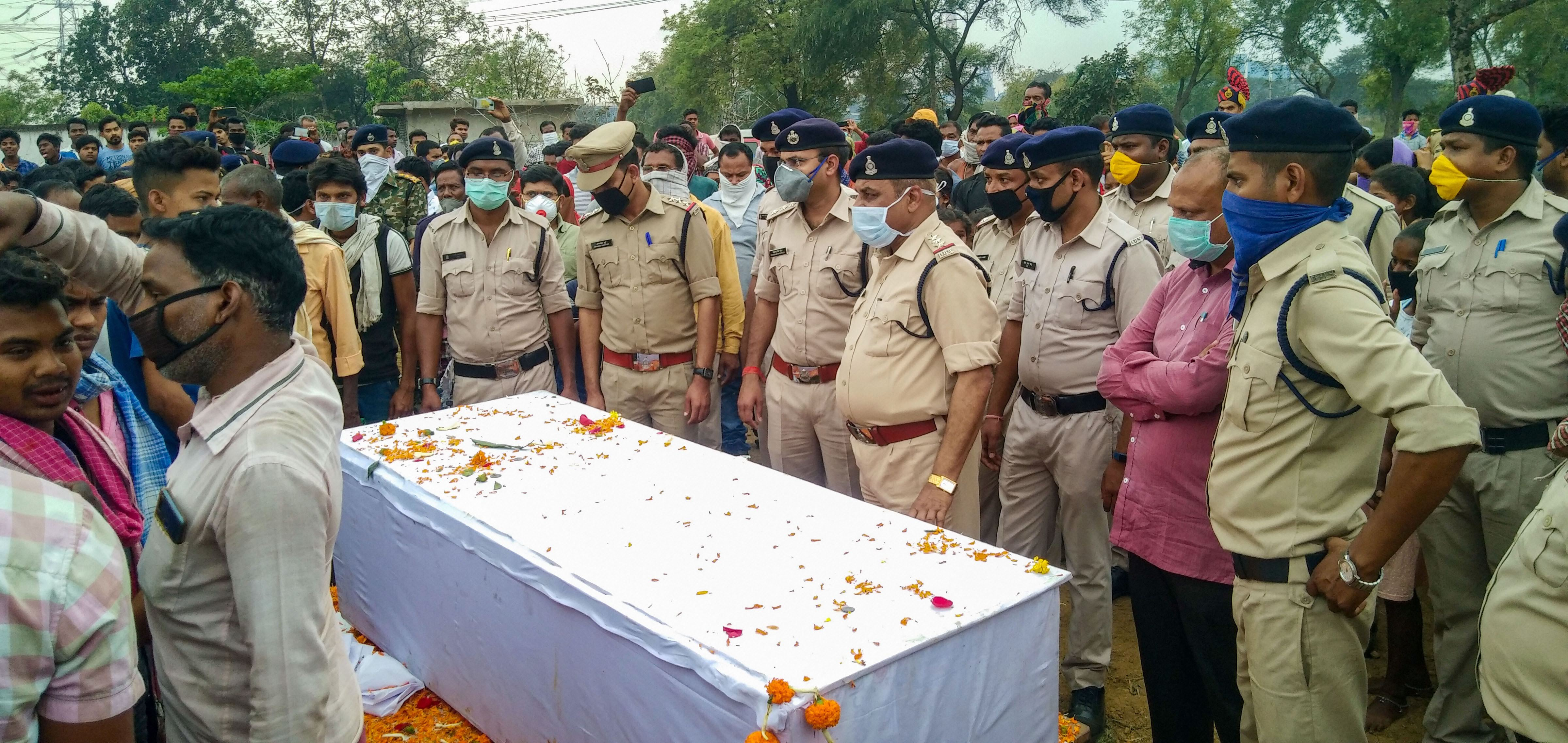 Chhattisgarh Police personnal pay tribute to martyrs who died in a fierce gun-battle with naxals in forests of Chhattisgarhs insurgency-hit Sukma district on March 21, 2020, at Sukma Police Line, Monday, March 23, 2020.