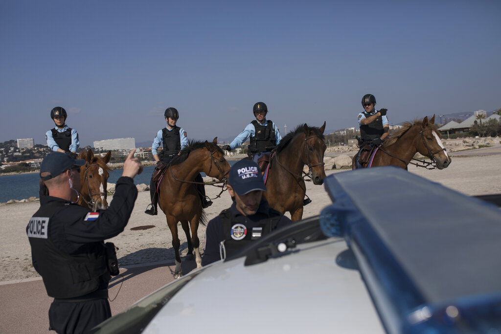 French police patrol a beach in Marseille, southern France, Thursday, March 19, 2020.