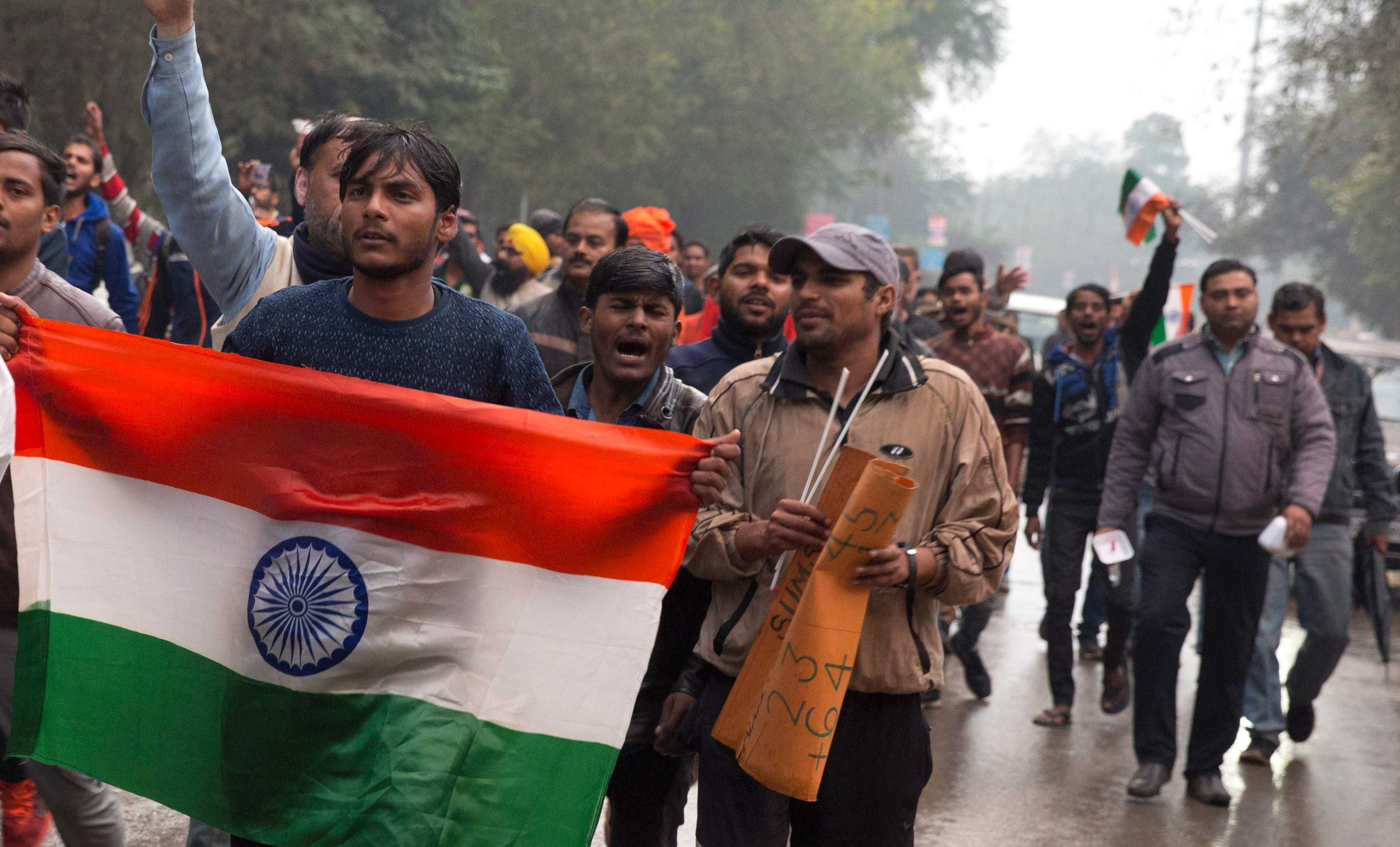 Protestors shout slogans against Thursday's attack on Indian soldiers, in Allahabad, on Friday.
