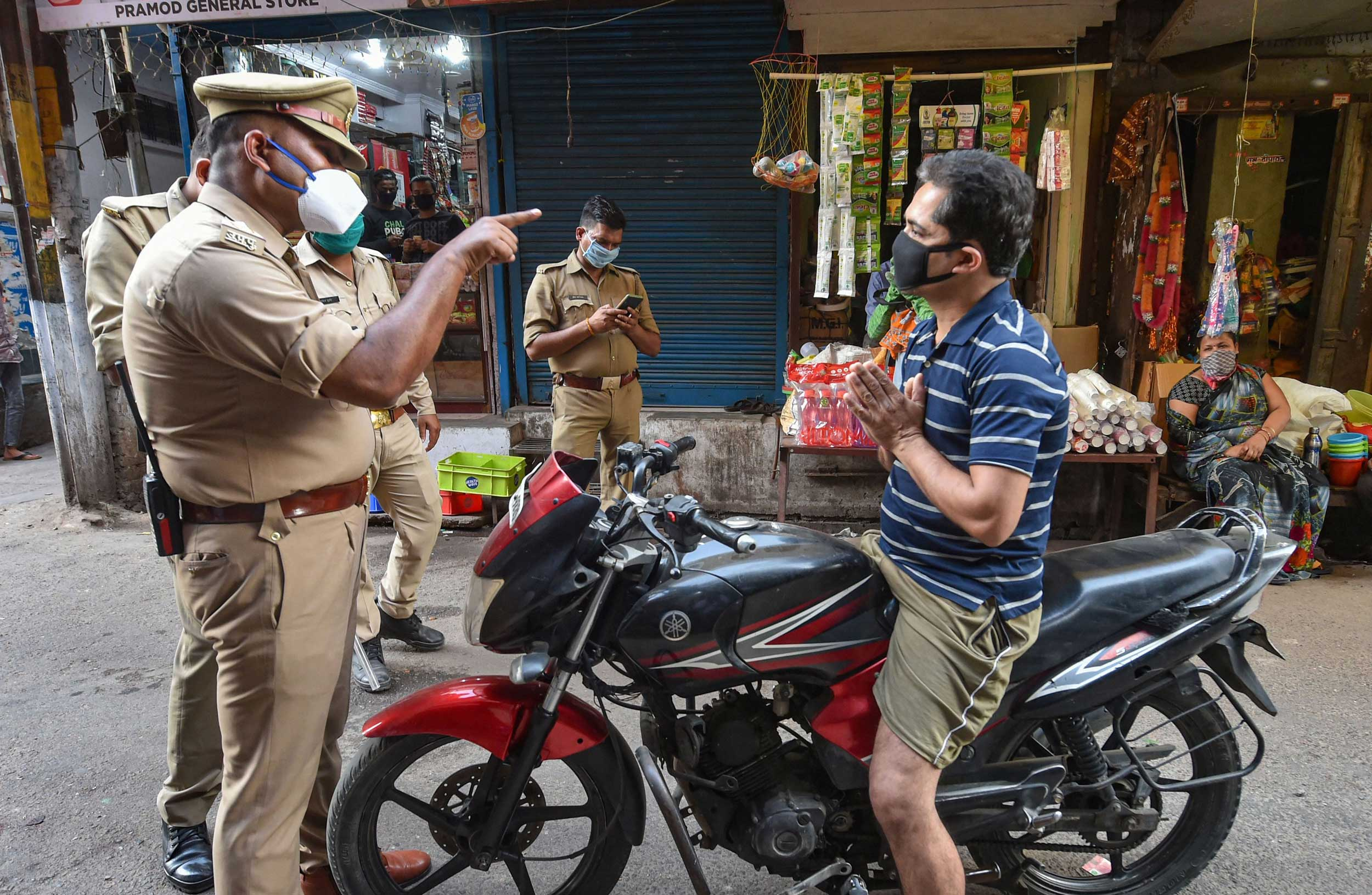 Cops stop commuters for flouting lockdown norms at Narahi market area in Lucknow on Saturday.