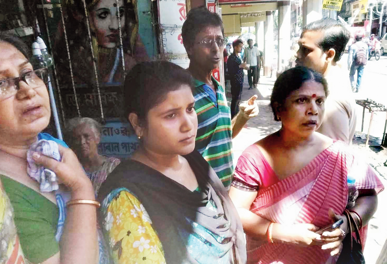 (From left) Susmita Roy, her daughter Debasree and their neighbour Smriti Chakraborty, all Durga Pituri Lane residents whose houses have either tilted or developed cracks.