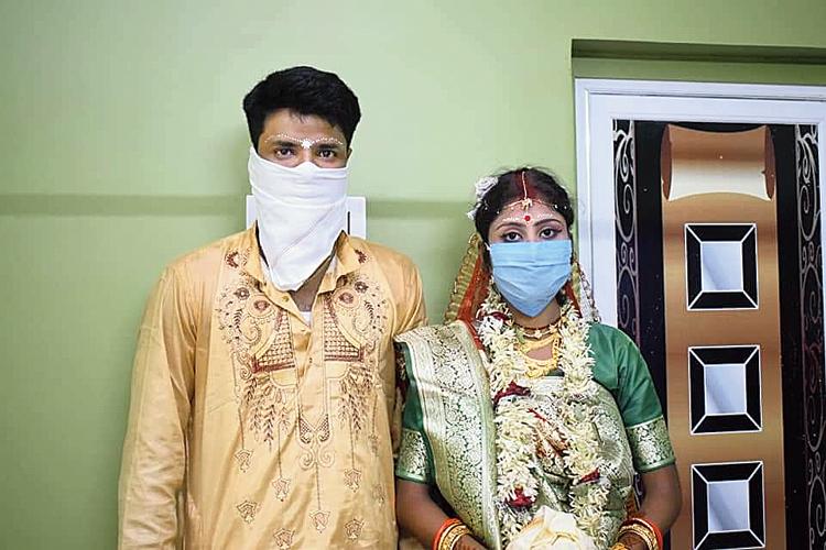 Prasanta Majhi and Papiya Majhi after their wedding in Durgapur on Friday.