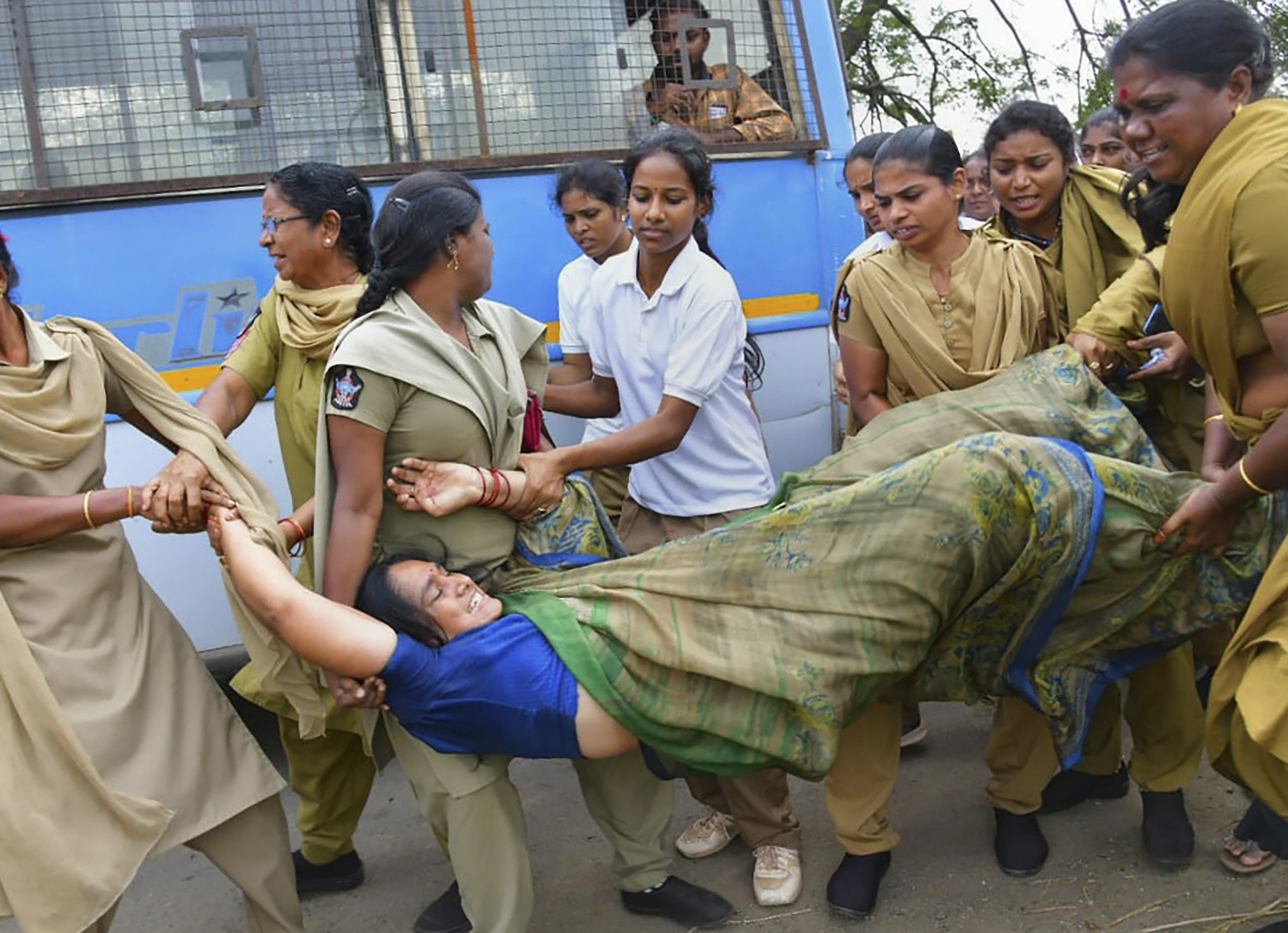 Police personnel detain a protester during a farmers' demonstration in Amaravati, Friday, January 10, 2020.