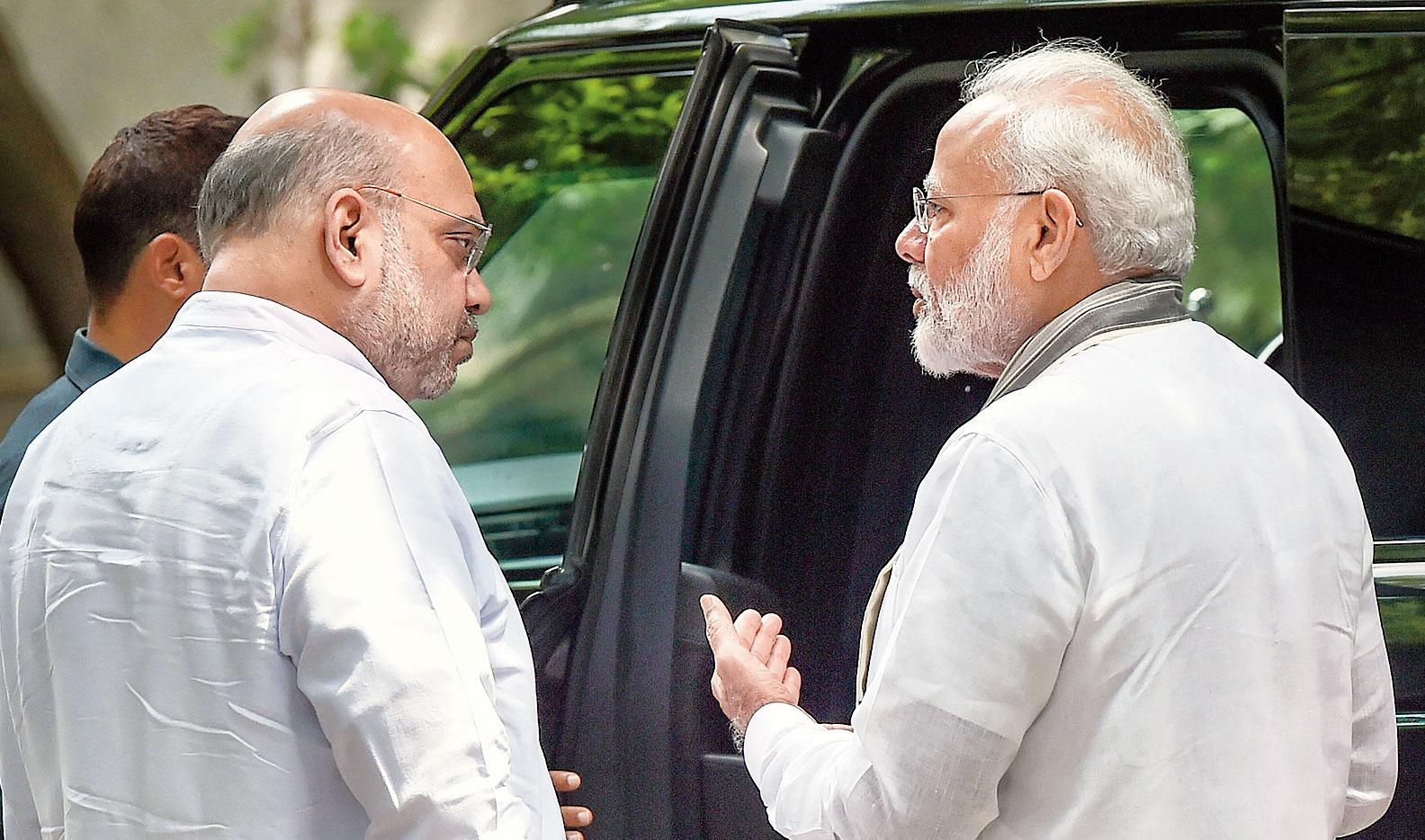 Amit Shah and Narendra Modi in New Delhi on Tuesday.