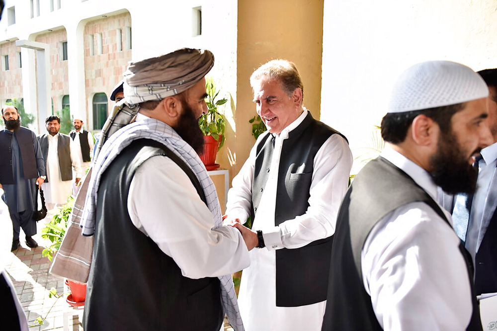 Pakistan's foreign minister Shah Mehmood Qureshi (centre) with members of the Taliban delegation in Islamabad on Thursday