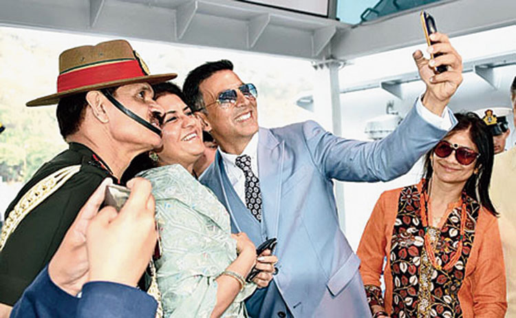 Actor Akshay Kumar takes a selfie with then army chief Dalbir Singh Suhag and others on board INS Sumitra on February 6, 2016
