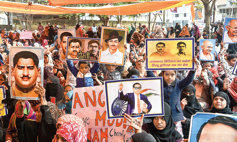 Women and children hold posters of freedom fighters at the protest in Allahabad on Wednesday