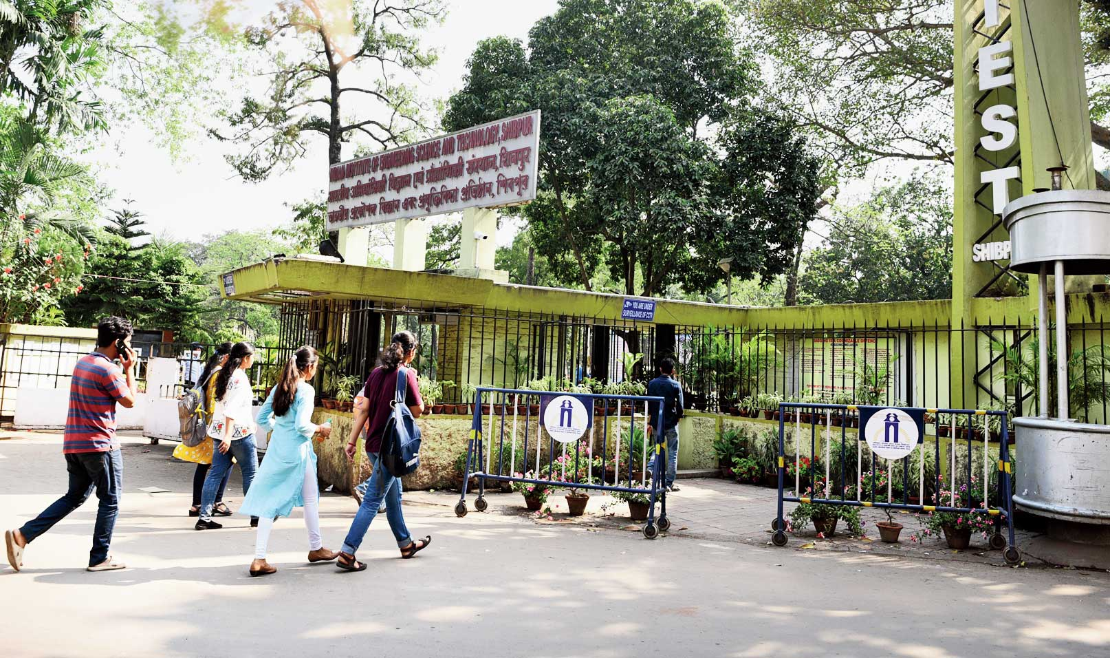 Barricades placed in front of the IIEST gate on Sunday; a newly-installed CCTV camera at the gate.