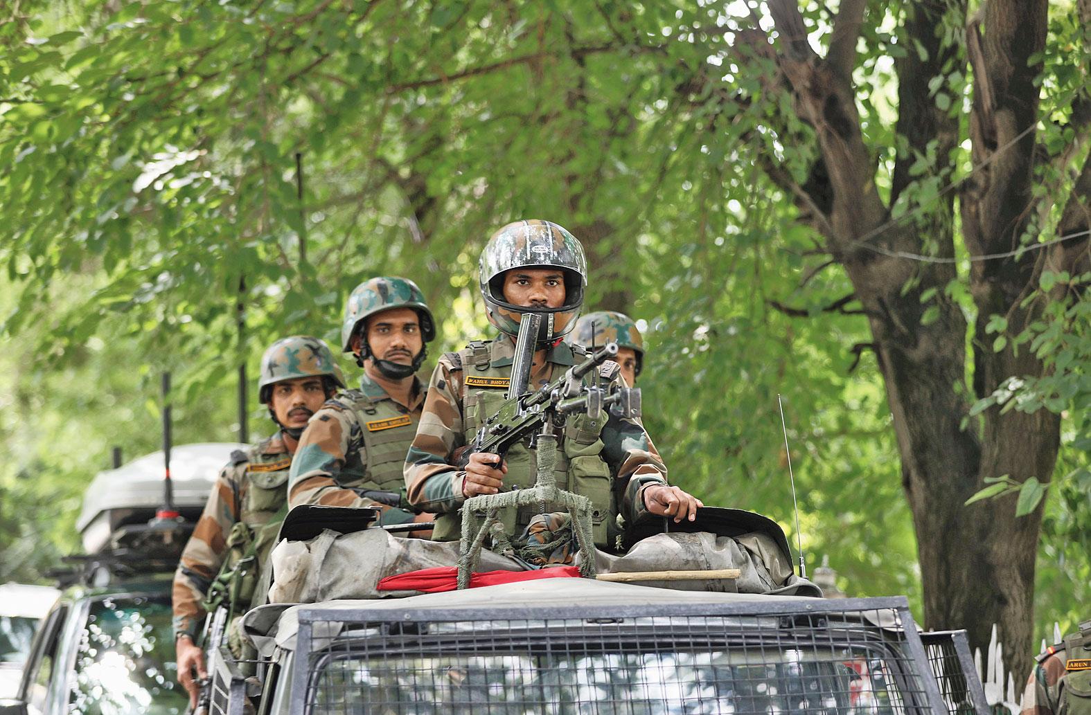 Soldiers on a vigil near a war memorial in Srinagar on Friday.