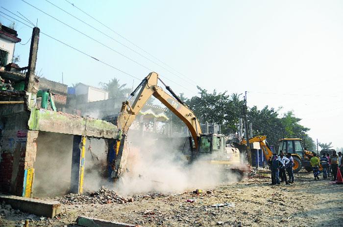 A shop along NH12 being dismantled near Krishnagar