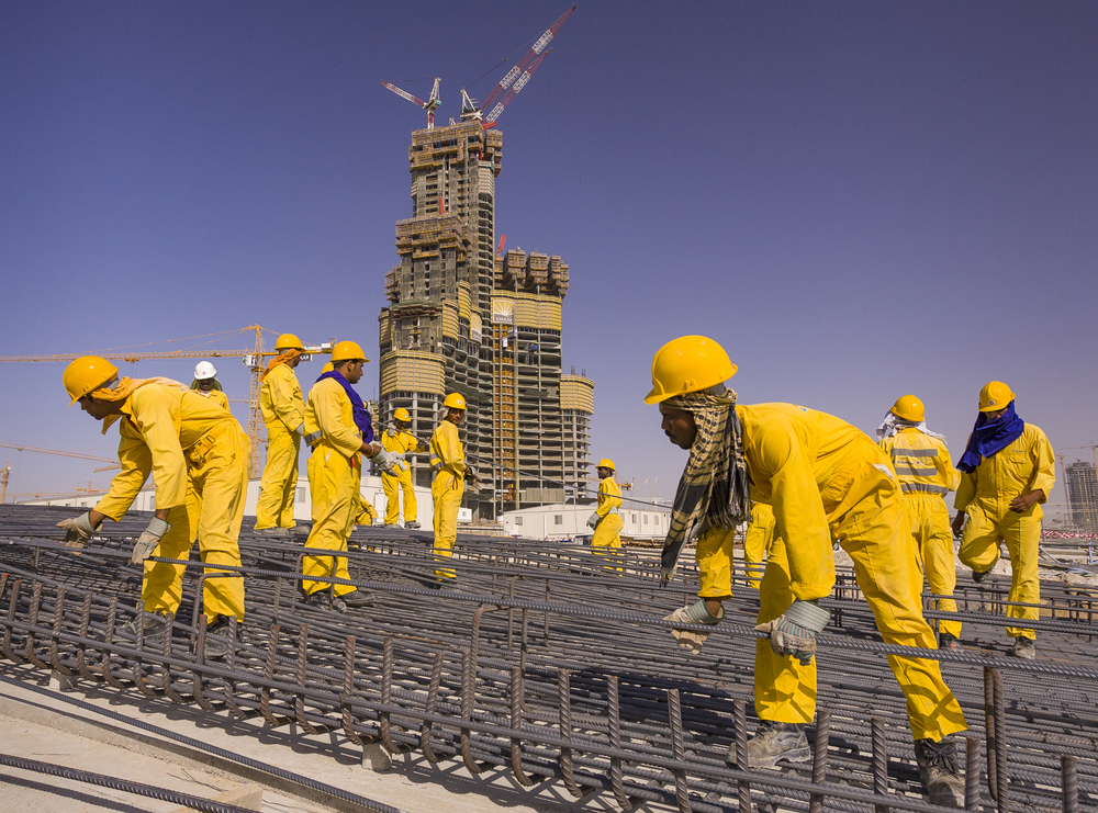 South Asian immigrant contract labourers from Bangladesh, India, and Pakistan work at the construction site of Burj Khalifa in Dubai.