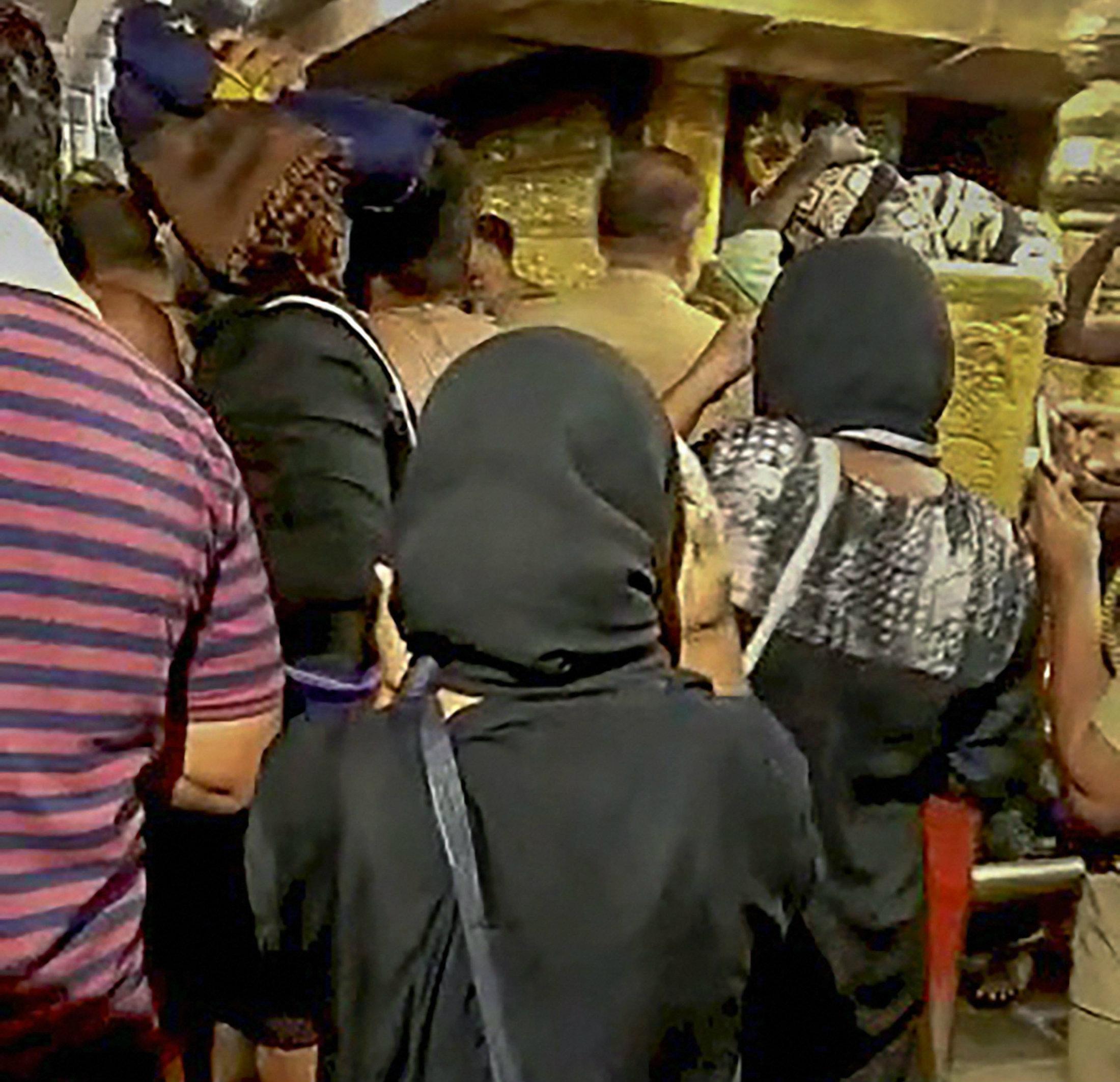 Bindu and Kanakadurga at the Sabarimala temple on Wednesday.
