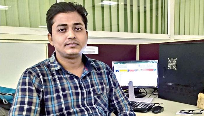 Rahaman at his workstation