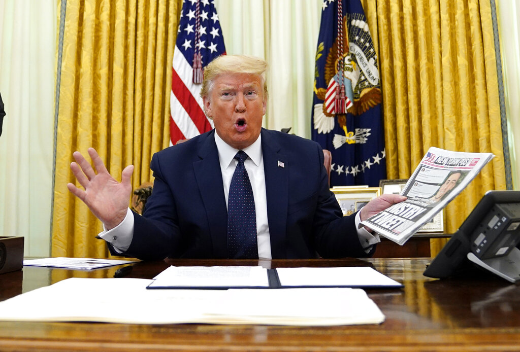 President Donald Trump speaks before signing an executive order aimed at curbing protections for social media giants, in the Oval Office of the White House, Thursday, May 28, 2020, in Washington.