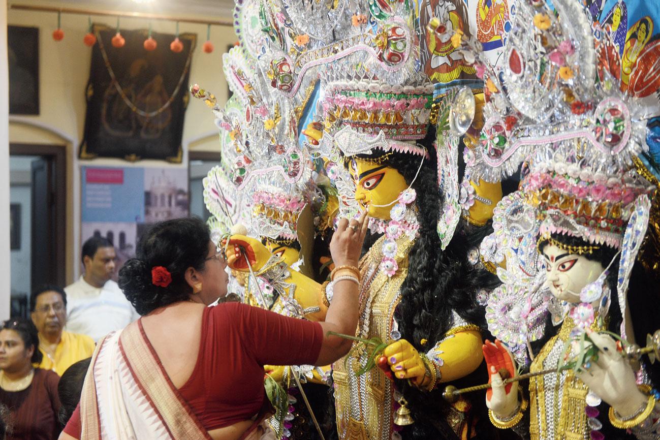 A pre-immersion ritual in the house of the Daws in north Calcutta.