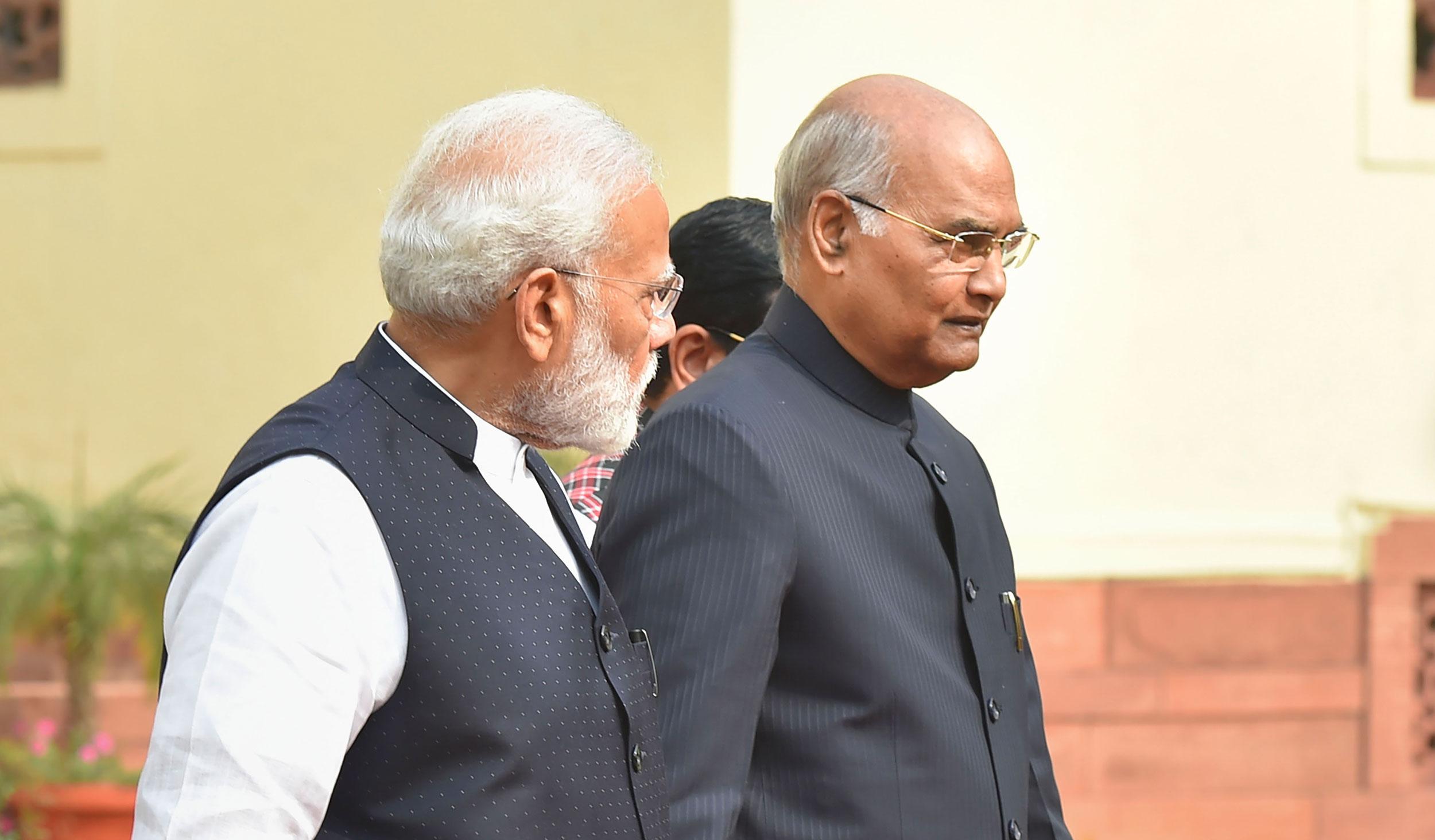President Ram Nath Kovind and Prime Minister Narendra Modi arrive for a function to commemorate 'Samvidhan Divas' at Parliament, in New Delhi, on November 26, 2019.