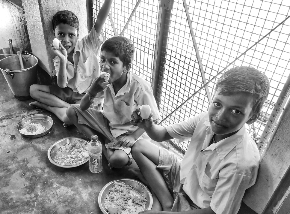 School children eat their free midday meal at a government school in Haryana. Recently, a case was registered against another journalist for making a video of a midday meal served at a primary school that purportedly shows the students being given only chapatti and salt in Uttar Pradesh.