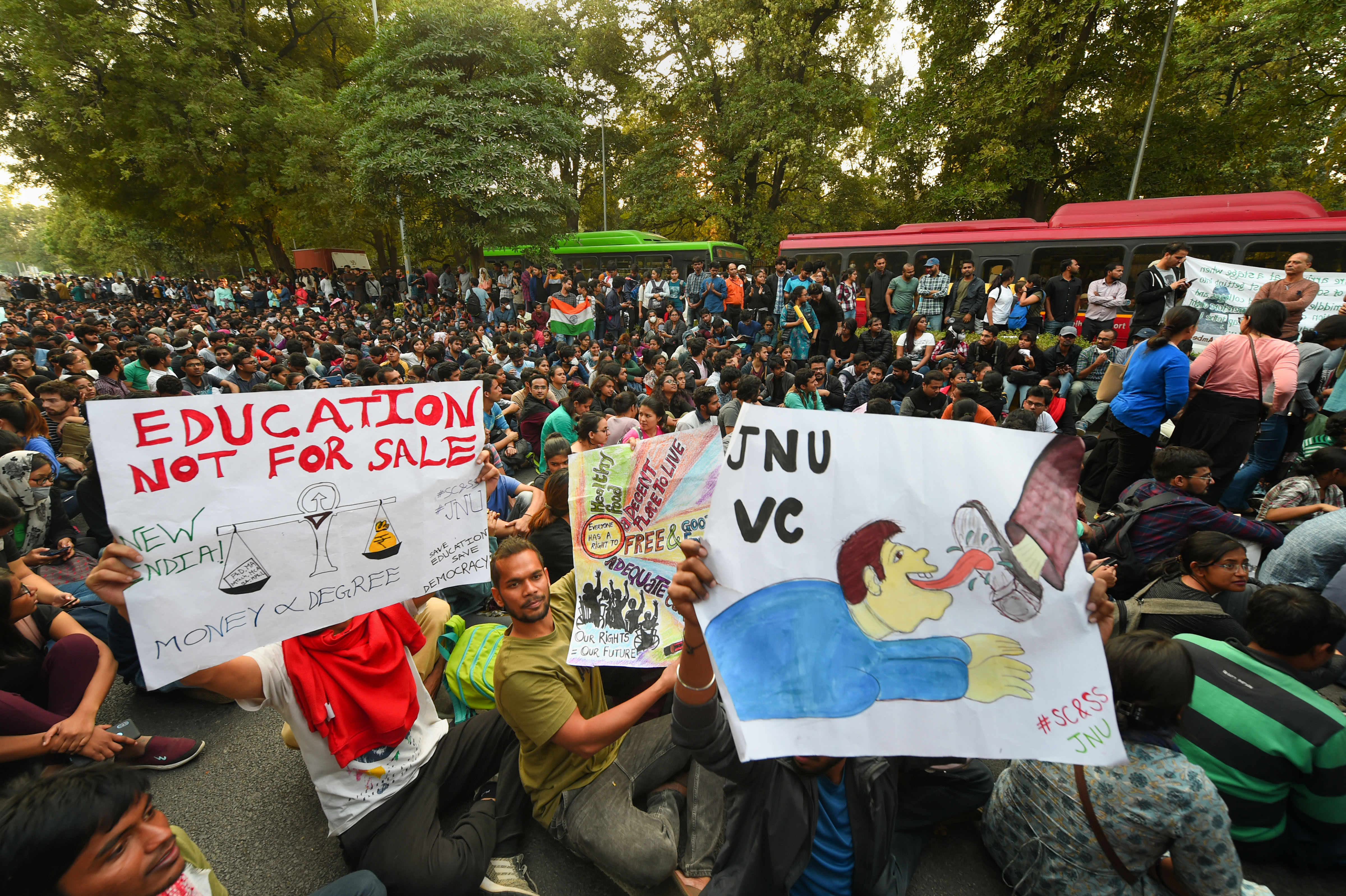 JNU students block a road in New Delhi as they protest demanding a total rollback of the hostel fee hike on November 18.