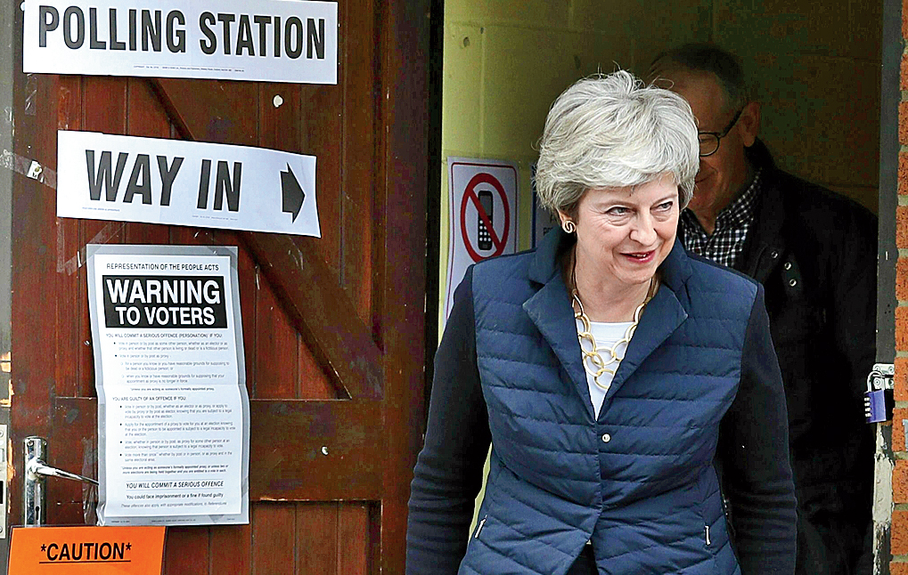 British Prime Minister Theresa May leaves after casting her vote in local elections in Sonning, England.