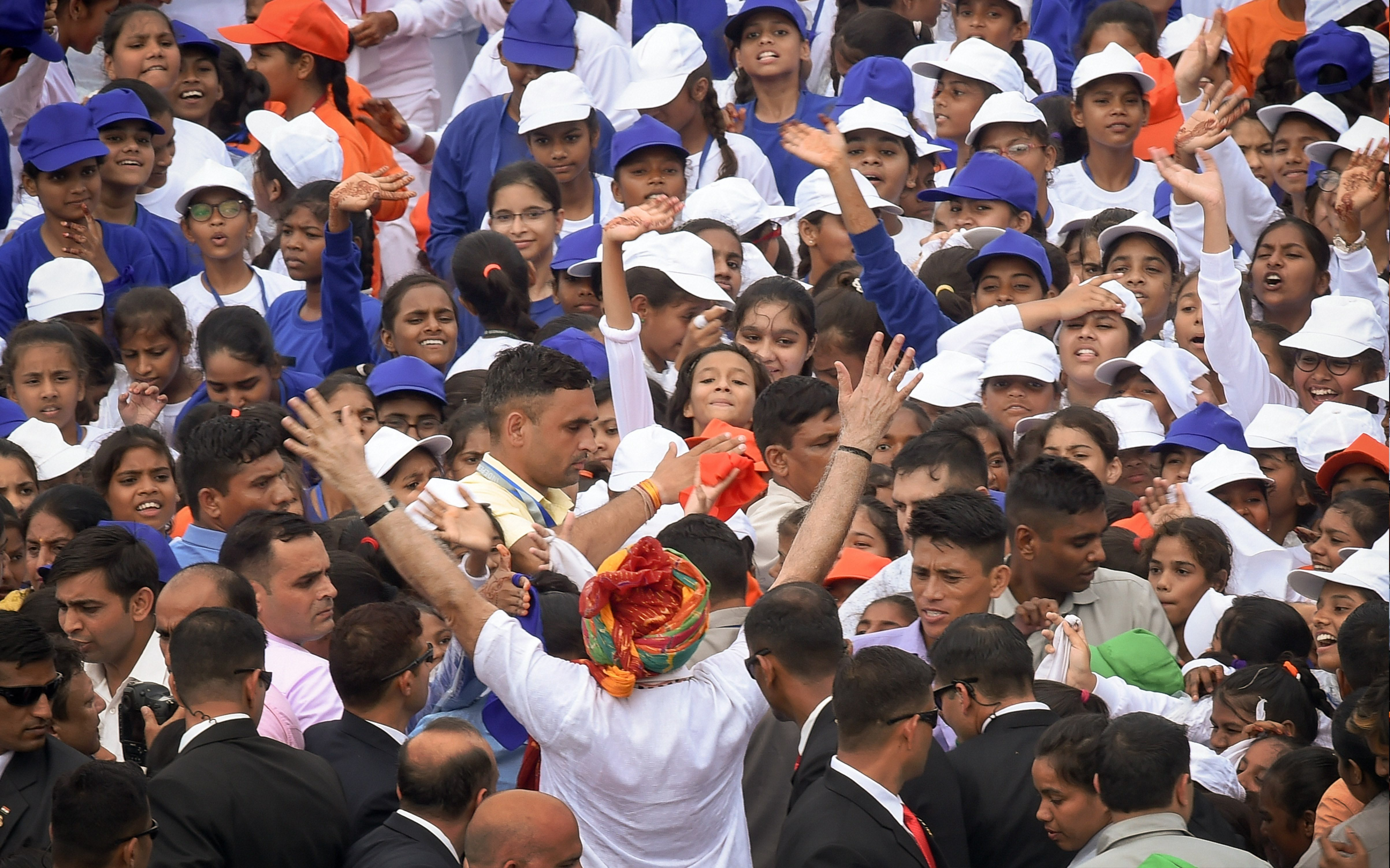 Modi greets schoolchildren after addressing the nation from the Red Fort on Independence Day.