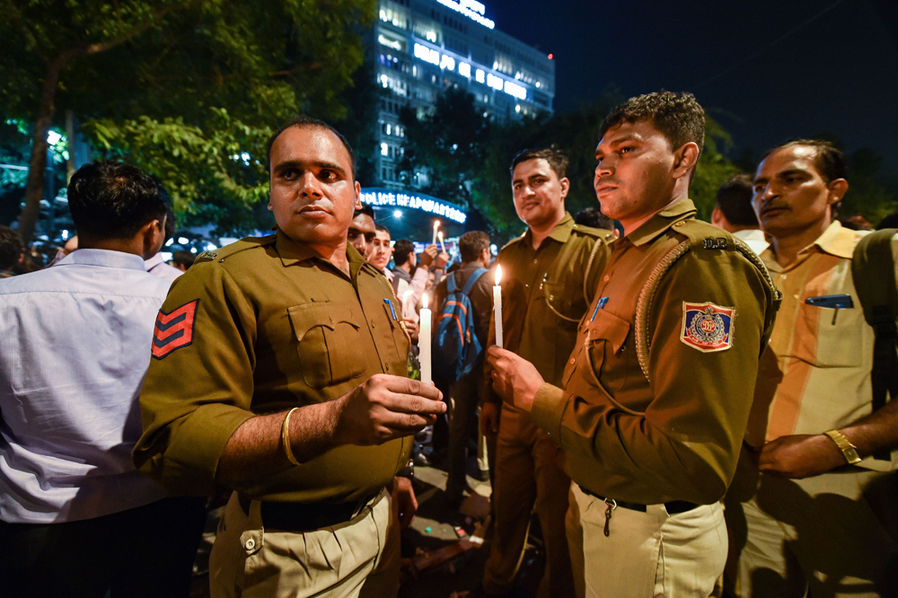 Delhi police personnel at a candlelight protest on Tuesday