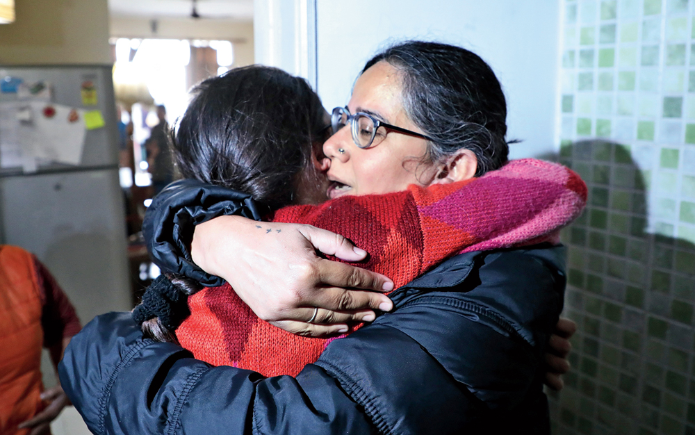 Social activist Sadaf Jafar hugs her daughter in Lucknow after she was released from jail on Tuesday